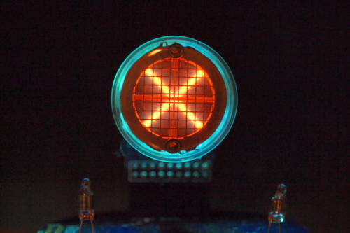Backlit Rodan CD-14 showing times sign